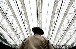 General view of an official with the roof closed on No.1 court at The All England Lawn Tennis Club, London.