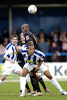 Photo: Olly Greenwood.<br />Colchester United v Brentford. Coca Cola League 1. 01/04/2006. Colchesters Chris Iwelumo and Brentford Marcus Gayle