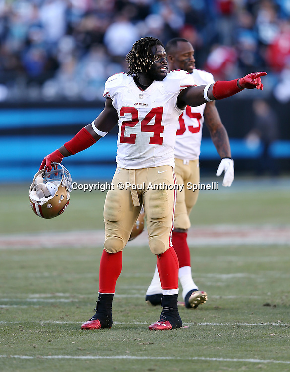 San Francisco 49ers running back Anthony Dixon (24) calls out and points during the NFC Divisional Playoff NFL football game against the Carolina Panthers on Sunday, Jan. 12, 2014 in Charlotte, N.C. The 49ers won the game 23-10. ©Paul Anthony Spinelli