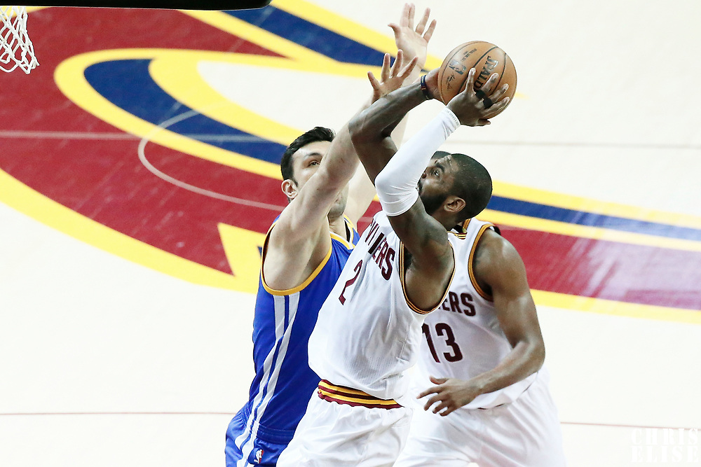 07 June 2017: Cleveland Cavaliers guard Kyrie Irving (2) takes a jump shots over Golden State Warriors center Zaza Pachulia (27) during the Golden State Warriors 118-113 victory over the Cleveland Cavaliers, in game 3 of the 2017 NBA Finals, at  the Quicken Loans Arena, Cleveland, Ohio, USA.