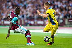 Matic Crnic of NK Domzale and Michail Antonio of West Ham during 2nd Leg football match between West Ham United FC and NK Domzale in 3rd Qualifying Round of UEFA Europa league 2016/17 Qualifications, on August 4, 2016 in London, England.  Photo by Ziga Zupan / Sportida