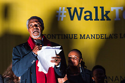 "London, October 23 2017. Nelson Mandela's group of Elders including former UN Secretary General Kofi Annan and Secretary General Ban Ki-moon accompanied by his widow Graca Machel gather at Parliament Square at the start of the Walk Together event in memory of Nelson Mandela before a candlelight vigil at his statue in Parliament Square. ""WalkTogether is a global campaign to inspire hope and compassion, celebrating communities working for the freedoms that unite us"". PICTURED: Kofi Annan addresses the gathering in Trafalgar Square.  © Paul Davey"