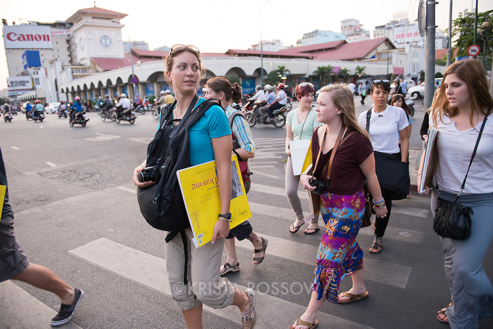 While in Vietnam, students in Professor Faye Serio's Drawing at Sea participated in a field lab in which they practiced perspective drawing while visiting multiple pagodas in Ho Chi Minh City. Students cross the street en route to a restaurant for dinner before returning to the ship.