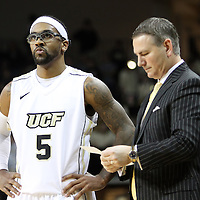 Central Florida guard Marcus Jordan (5) and Central Florida head coach Donnie Jones during a Conference USA NCAA basketball game between the Memphis Tigers and the Central Florida Knights at the UCF Arena on February 9, 2011 in Orlando, Florida. Memphis won the game 63-62. (AP Photo: Alex Menendez)
