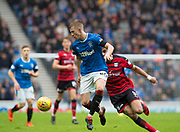 7th April 2018, Ibrox Stadium, Glasgow, Scotland; Scottish Premier League football, Rangers versus Dundee; Ross McCrorie of Rangers on the ball as Sofien Moussa of Dundee chases him
