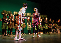 "Simba (Taylor Browne) and Nala (Mae Kenney find each other in the grasslands during Monday afternoon dress rehearsal for ""The Lion King"" production with the Gilford Middle School.  (Karen Bobotas/for the Laconia Daily Sun)"