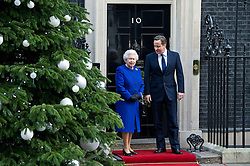 © London News Pictures. 18/12/2012. London, UK. HRH QUEEN ELIZABETH II  being greeted by British Prime Minister DAVID CAMERON outside 10 Downing street on December 18, 2012. The Queen is due to observe the government cabinet meeting and receive a gift to mark the Diamond Jubilee, becoming the first monarch to attend the briefing since Queen Victoria.  Photo credit: Ben Cawthra/LNP.
