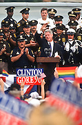President Bill Clinton waves to his supporters during a campaign stop for his re-election August 28, 1996 in Royal Oak, MI