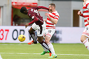 Hearts FC Midfielder Arnaud Djoum and Hamilton Academical Midfielder Darian MacKinnon collide during the Ladbrokes Scottish Premiership match between Hamilton Academical FC and Heart of Midlothian at New Douglas Park, Hamilton, Scotland on 24 January 2016. Photo by Craig McAllister.