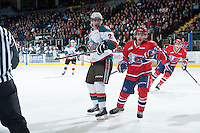 KELOWNA, CANADA - JANUARY 16:  Cole Linaker #26 of the Kelowna Rockets follows the puck as Connor Chartier #27 of the Spokane Chiefs skates behind at the Kelowna Rockets on January 16, 2013 at Prospera Place in Kelowna, British Columbia, Canada (Photo by Marissa Baecker/Shoot the Breeze) *** Local Caption ***