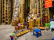 "24 DECEMBER 2017 - HANOI, VIETNAM: A woman sets out traditional Vietnamese pipes she sells in her bamboo shop in the old quarter of Hanoi. The old quarter is the heart of Hanoi, with narrow streets and lots of small shops but it's being ""gentrified"" because of tourism and some of the shops are being turned into hotels and cafes for tourists and wealthy Vietnamese.           PHOTO BY JACK KURTZ"