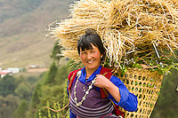 Woman wearing a kira carrying a basket
