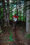 A mountain biker goes through the downhill course of the Superior Bike Fest competition at Marquette Mountain in Marquette, Mich.