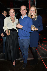 Left to right, MARTHA SITWELL, THOMAS ROBINSON and CAMILLA CRESWELL at a party in aid of the Youth at Risk charity held at Raffles, 287 King's Road, London on 27th November 2013.