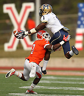 Montana State's Elvis Akpla (1) makes a leaping reception over Sam Houston's Daxton Swanson during the first half of a NCAA Division I football playoff quarterfinal, Saturday, December 10, 2011 at Bowers Stadium in Huntsville, TX.