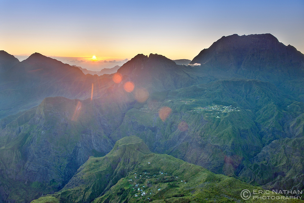 The sun rising over the Cirque de Mafate caldera, part of Reunion Island National Park on the French island of Reunion in the Indian Ocean.