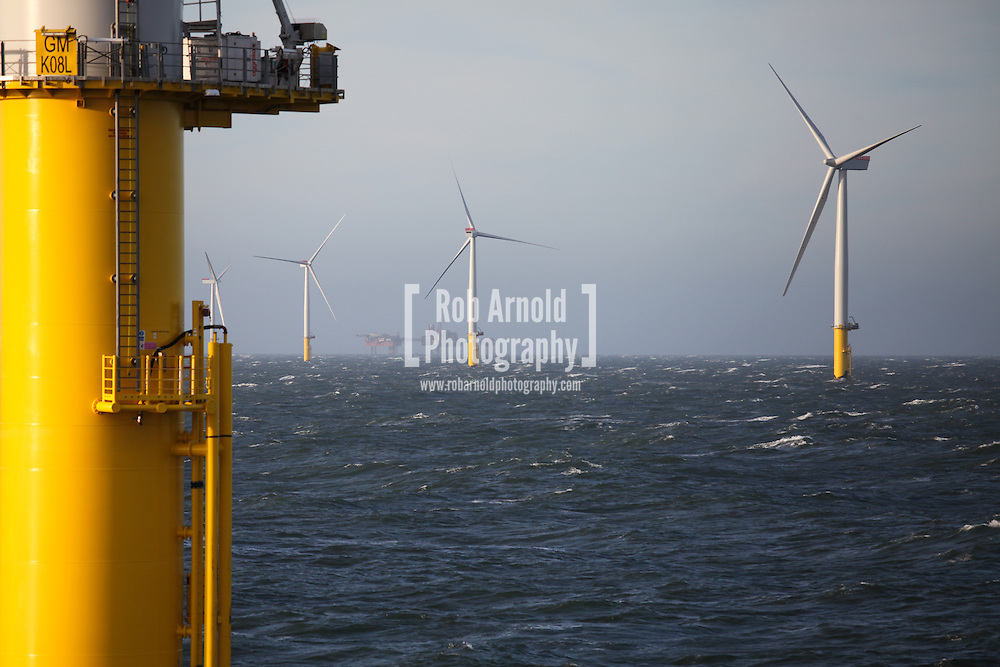 19/03/2014. Gwnt y Mor Wind Farm, North Wales, UK. A view of the turbines and foundations on the Gwynt y Mor Offshore Wind Farm off the coast of North Wales. The oil platforms of the Douglas Complex can be seen on the horizon. Photo credit : Rob Arnold