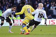 Derby County midfielder Will Hughes (19) goes in hard on Sheffield Wednesday defender Jeremy Helan (17) during the Sky Bet Championship match between Derby County and Sheffield Wednesday at the iPro Stadium, Derby, England on 21 February 2015. Photo by Aaron Lupton.