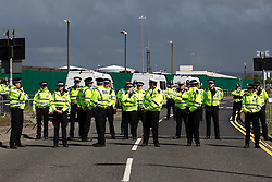 © licensed to London News Pictures. Ellesmere Port, UK 08/05/2011. Lines of police hold back fuel protesters who establish a blockade outside the Stanlow Oil Refinery at Ellesmere Port, Cheshire. Organiser, Ian Charlesworth says that a 24 pence discount off the price of a litre of petrol is required to bring the UK in line with average European pricing and to keep British businesses competitive. He says he is expecting more than 1000 vehicles to turn up and is expecting to stay for at least a week. Please see special instructions for usage rates. Photo credit should read Joel Goodman/LNP