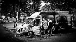 A year anniversary of the Tottenham Riots...The owners of the burnt out van inspect the damaged caused  after the riots in Tottenham which took place last night Saturday August 6, 2011, against the police. Sunday August 7, 20111. Picture by Andrew Parsons/i-Images