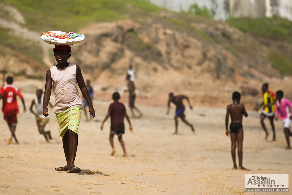 A girl sells candy on the beach in Cape Coast, Ghana on Sunday September 7, 2008.