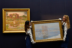 "© Licensed to London News Pictures. 06/10/2017. London, UK. (L to R) ""Les Arceaux De Roses, Giverny"", 1913 and ""Les Glaçons, Bennecourt"", 1893, both by Claude Monet at a preview at Sotheby's in New Bond Street of contemporary, impressionist and modern art works to be auctioned in New York in November 2017 Photo credit : Stephen Chung/LNP"