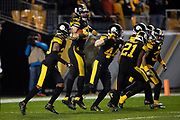 The Pittsburgh Steelers celebrate after Pittsburgh Steelers linebacker Anthony Chickillo (56) recovers a third quarter Carolina Panthers fumble at the Panthers 9 yard line during the NFL week 10 regular season football game against the Carolina Panthers on Thursday, Nov. 8, 2018 in Pittsburgh. The Steelers won the game 52-21. (©Paul Anthony Spinelli)