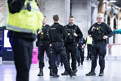 © Licensed to London News Pictures . FILE PICTURE DATED 31/12/2018 of police sealing off a platform at Victoria Station in Manchester as Mahdi Mohamud is due to appear at Manchester Crown Court today (Tuesday 26 November 2019) charged  with 3 counts of attempted murder and 1 count contrary to Section 58 (1) (a), TACT 2000 which relates to the possession of a document or record likely to be useful to a person committing or preparing an act of terrorism . On the evening of 31st December 2018 , as thousands headed in to Manchester City Centre to watch New Years Day fireworks , three people including a British Transport Police Officer were stabbed and a man was tasered on a Metrolink platform of Victoria Train Station in Manchester . Photo credit : Joel Goodman/LNP