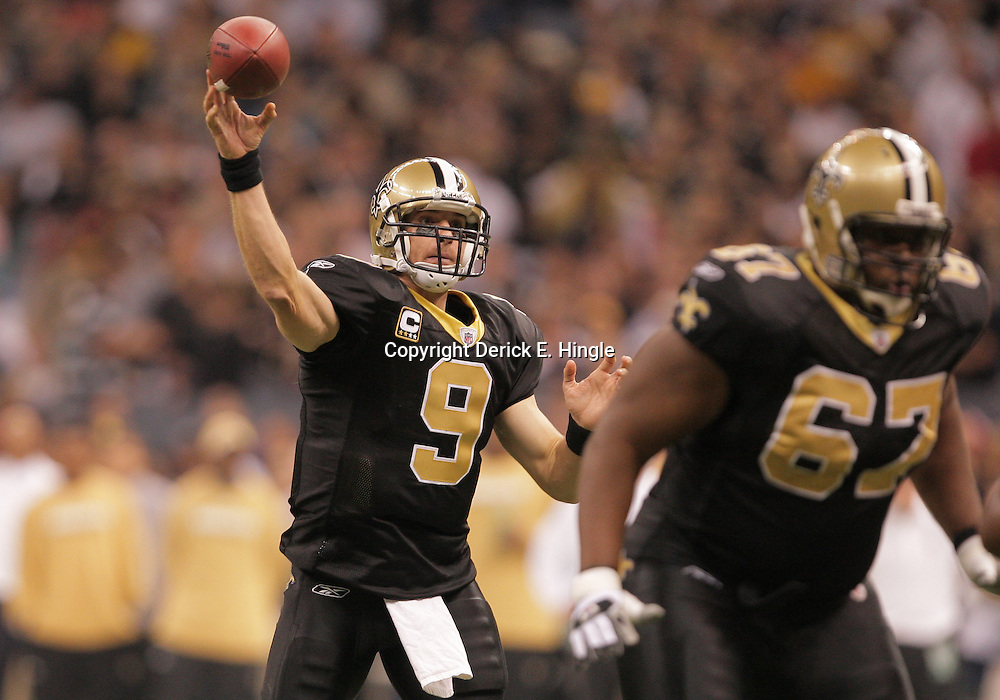 2008 November, 24: New Orleans Saints quarterback Drew Brees (9) throws a touchdown pass to Lance Moore (not pictured) during the first half of a Monday Night Football against the Green Bay Packers at the Louisiana Superdome in New Orleans, LA.