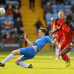 TELFORD COPYRIGHT MIKE SHERIDAN 16/2/2019 - Lewis Baines of Stockport clears under pressure from Dan Udoh of AFC Telford during the Vanarama Conference North fixture between Stockport County and AFC Telford United at Edgeley Park
