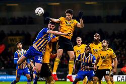 Raul Jimenez of Wolverhampton Wanderers beats Luke Waterfall of Shrewsbury Town to a header - Mandatory by-line: Robbie Stephenson/JMP - 05/02/2019 - FOOTBALL - Molineux - Wolverhampton, England - Wolverhampton Wanderers v Shrewsbury Town - Emirates FA Cup fourth round replay