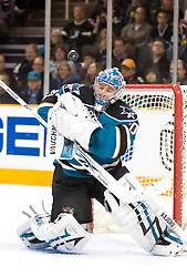 January 23, 2010; San Jose, CA, USA; San Jose Sharks goalie Evgeni Nabokov (20) makes a save as the puck deflects off his glove during the third period against the Buffalo Sabres at HP Pavilion. San Jose defeated Buffalo 5-2. Mandatory Credit: Jason O. Watson / US PRESSWIRE