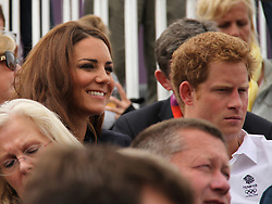 © licensed to London News Pictures. London, UK. 01/08/2012. Duchess of Cambridge Katherine (Kate) Middleton (left) and Prince Harry watching Zara Phillips compete at Olympic Equestrian Showjumping at Greenwich Park on August 1, 2012. Photo credit: Russell Marsh/LNP