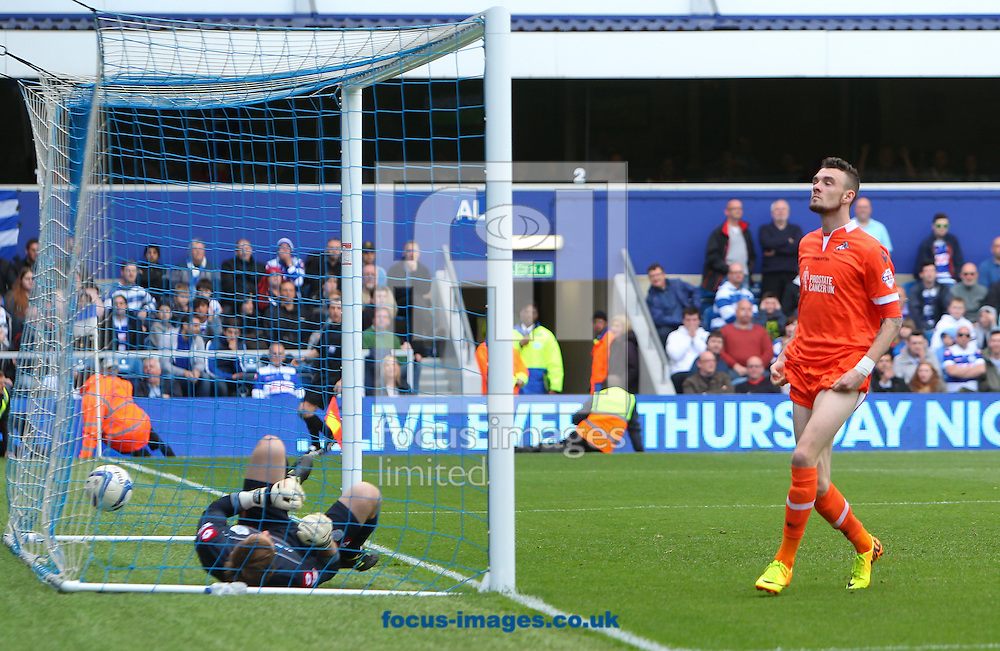 Rob Green of Queens Park Rangers ends up in the net as Scott Malone of Millwall celebrates scoring the equaliser during the Sky Bet Championship match at the Loftus Road Stadium, London<br /> Picture by John Rainford/Focus Images Ltd +44 7506 538356<br /> 26/04/2014