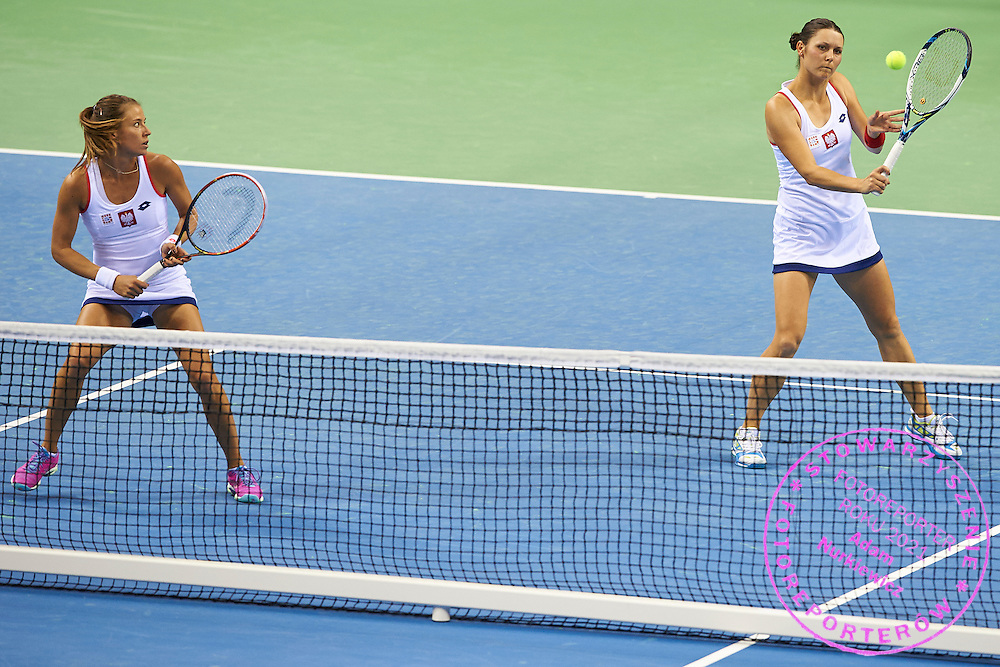 (L) Alicja Rosolska and (R) Klaudia Jans Ignacik both from Poland in action during Second Day of the Fed Cup / World Group 1st round tennis match between Poland and Russia at Tauron Krakow Arena on February 8, 2015 in Cracow, Poland.<br /> <br /> Poland, Cracow, February 8, 2015<br /> <br /> Picture also available in RAW (NEF) or TIFF format on special request.<br /> <br /> For editorial use only. Any commercial or promotional use requires permission.<br /> <br /> Adam Nurkiewicz declares that he has no rights to the image of people at the photographs of his authorship.<br /> <br /> Mandatory credit:<br /> Photo by &copy; Adam Nurkiewicz / Mediasport