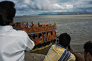 People taking picture of the ferry with their mobile. They saw something that I missed. South Mumbai, Maharashtra.