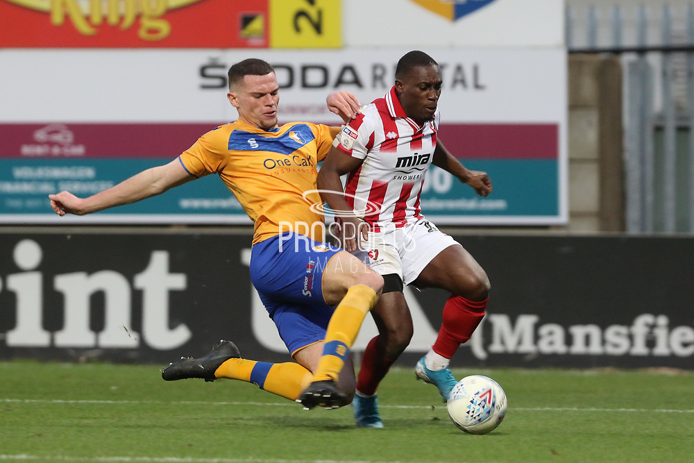 Matt Preston and Alex Addai  during the EFL Sky Bet League 2 match between Mansfield Town and Cheltenham Town at the One Call Stadium, Mansfield, England on 7 December 2019.
