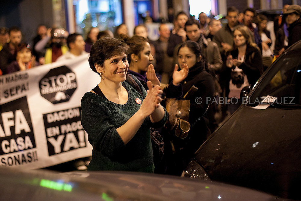Tatyana Roeva thanks while she hear that she got a lie of payment and two months rent for free at the end of an Anti-eviction demonstration on February 28 2012. Banner reads 'Stop evictions. Lieu of payment now'. Bulgarian Tatyana Roeva, and husband Anuar Jalil 55, from Libano, await their second evition since last June 2011 their first eviction meant the starting of the Anti-eviction movement. A day before their eviction February 29, 2012 a demonstration of hundreds of people takes part in Madrid claiming a lieu of payment for evicted families and social accomodation. During the demonstration lawyer Rafael Mayoral and the Anti-eviction organization got a deal with BBVA Bank for a lieu of payment of 269.000â¬, plus two months paid accomodation, but the couple needs to leave their house that night.