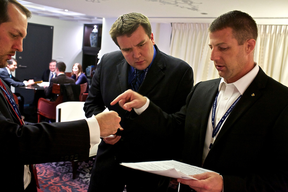 Congressman-elect Markwayne Mullin, from Oklahoma's 2nd District, right, looks over resumes with staff member Tim Ross, center, and advisor Trebor Worthen, left, in the lobby of the Capitol Hill Hotel in Washington, DC on Nov. 29, 2012. Into his second week of orientation, Congressman-elect Mullin is deciding everything from who will be on his staff to what office furniture he will have.