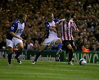 Photo: Steve Bond.<br />Birmingham City v Sunderland. The FA Barclays Premiership. 15/08/2007.  Sebastian Larsson (C) attempts a tackle on Ross Wallace (R)