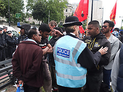© licensed to London News Pictures. London, UK. 6/06/12. Protestor argues with police on the protest. Demonstration takes place outside the Hilton Hotel, Park lane, over the attendance of the Sri Lankan president Mahinda Rajapaksa, accused of presiding over human rights abuses, at the Commonwealth Lunch with the Queen. Photo credit: Jules Mattsson/LNP