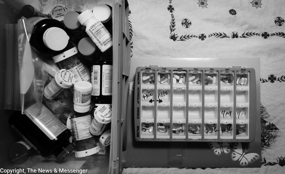 Maria organizes Ricky's pills.  The financial stress of caring for a paralyzed individual can inflict incredible amounts of debt.  Often fundraisers and aid from non-profit organizations are required to help diffuse the costs.  Ricky needs many different forms of medication in order to mitigate pain and other ailments like muscle spasms that are associated with prolonged paralysis. For The News & Messenger (Manassas, VA)