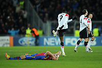 Football - Champions League - FC Basel vs. Manchester United<br /> Danny Welbeck of Manchester United kicks at the grass as the Basel players celebrate going through to the knockout rounds at St. Jakob Park, Basel