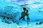 Snorkeling couple, Rangiroa, French Polynesia