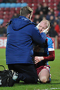 Neil Bishop of Scunthorpe United receives treatment for injury during the Sky Bet League 1 match between Scunthorpe United and Colchester United at Glanford Park, Scunthorpe, England on 23 January 2016. Photo by Ian Lyall.
