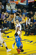 Oklahoma City Thunder guard Russell Westbrook (0) falls into Golden State Warriors guard Klay Thompson (11) at Oracle Arena in Oakland, Calif., on November 3, 2016. (Stan Olszewski/Special to S.F. Examiner)