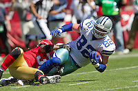 18 September 2011: Tight end (82) Jason Witten of the Dallas Cowboys catches a pass and is tackled by (31) Donte Whitner of the San Francisco 49ers during the first half of the Cowboys 27-24 overtime victory against the 49ers in an NFL football game at Candlestick Park in San Francisco, CA