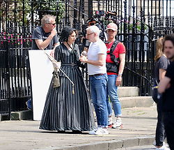 "Moray Place in Edinburgh's Georgian old town was turned into 19th century London for Julian Fellowes' new ITV show ""Belgravia"".<br /> <br /> Pictured: Tamsin Greig (striped dress) talks to director John Alexander (white tee-shirt)<br /> <br /> Alex Todd 