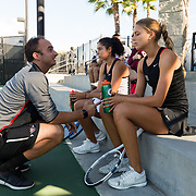 10 November 2017:  The San Diego State Aztecs women's tennis team hosts it's annual Fall Classic II. Assistant coach Nicolas Vinel  talked with Jana Buth and Paola Diaz de Regules during break in a doubles match.<br /> www.sdsuaztecphotos.com