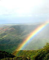 Aerial view taken from a helicopter of a brilliant rainbow over Hawaii